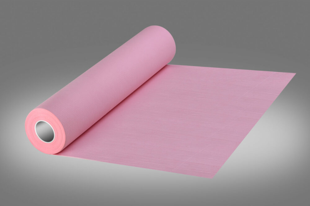 Podkład higieniczny w kolorze różowym.